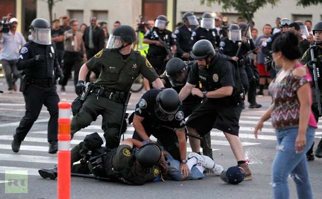 protester-police-officers-try.jpg